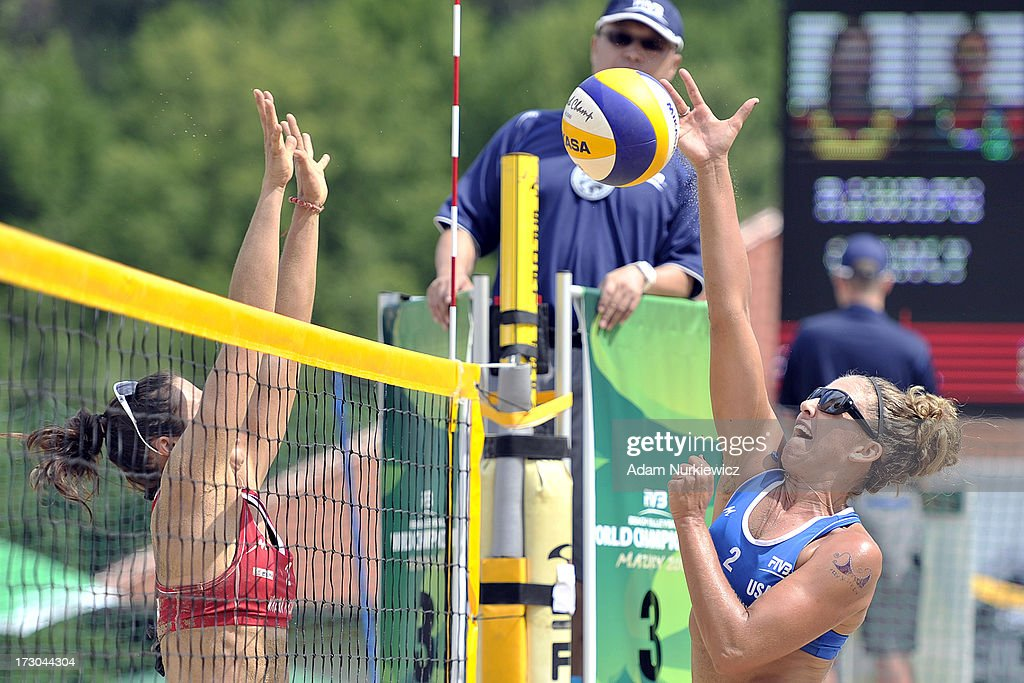 Whitney Pavlik (R) from USA attacks during the match between USA and Spain during Day 5 of the FIVB World Championships on July 5, 2013 in Stare Jablonki, Poland.