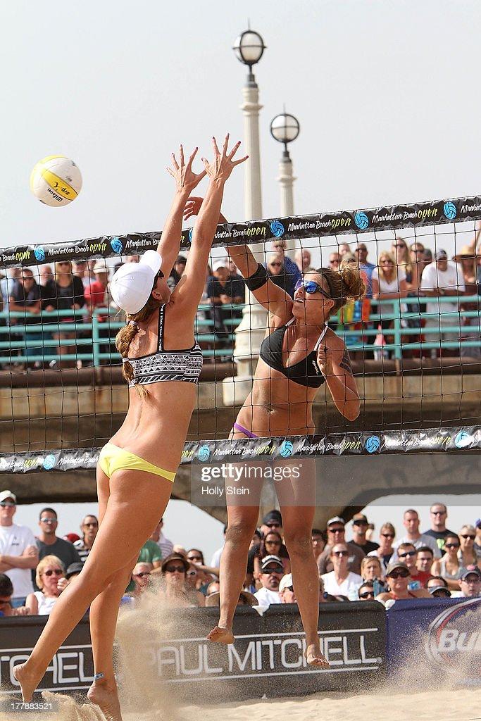 Whitney Pavlik (R) hits the ball past Jennifer Fopma during the women's finals at the AVP Manhattan Beach Open on August 25, 2013 in Manhattan Beach, California. Pavlik and her partner Kerri Walsh Jennings defeated Jennifer Fopma and Brooke Sweat 22-20, 21-17.