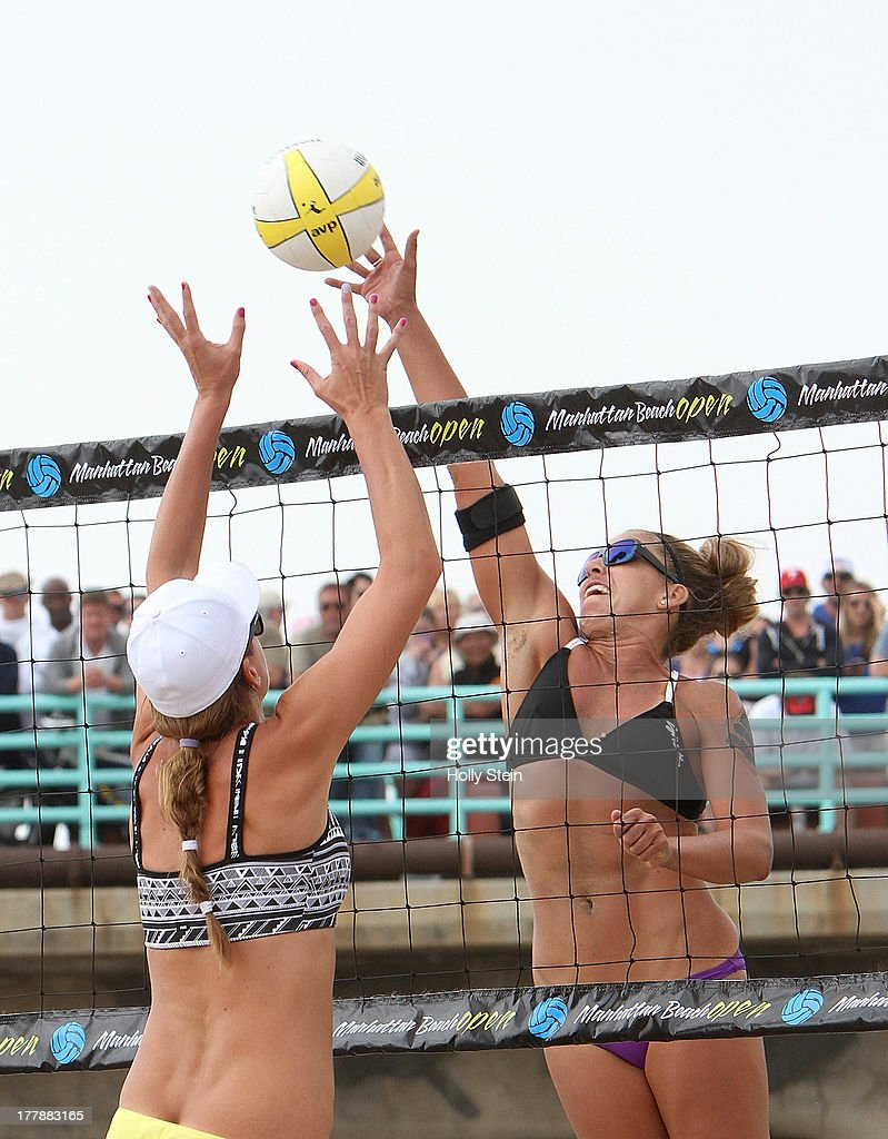 Whitney Pavlik (R) tries to get the ball past Jennifer Fopma (L) during the women's finals at the AVP Manhattan Beach Open on August 25, 2013 in Manhattan Beach, California. Pavlik and her partner Kerri Walsh Jennings 22-20, 21-17.