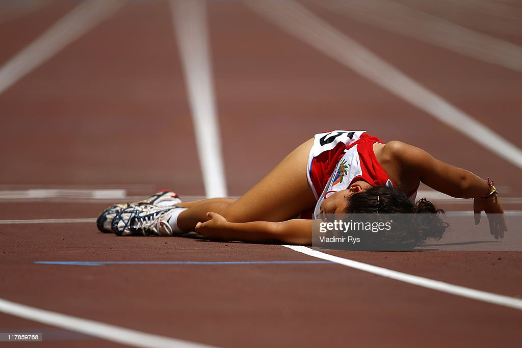 Whitney Ramirez of Costa Rica falls exhausted after completing the 800 meters run at the of the Athens 2011 Special Olympics World Summer Games on July 1, 2011 in Athens, Greece.