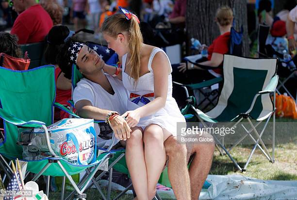 Whitney Thomas of Ipswich and Garrett Snyder of Tully NY share a moment near the Hatch Shell as they wait for the Boston Pops Fourth of July concert...