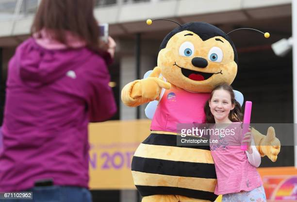 Whizbee the Bee mascot for the World Para Athletics Championships his their photo taken with a child from the Learning Begins in Wonder group after...