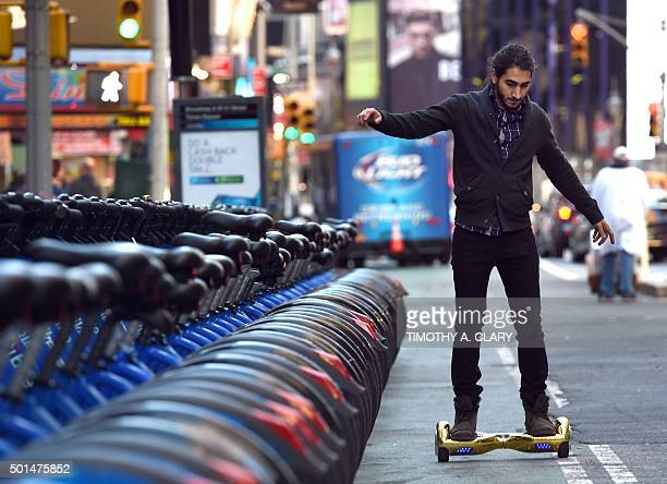 Whizboard Store manager 'Mor Loud' demonstrates the Hoverboard on Broadway in Times Square December 15 2015 The hot item on many holiday lists will...