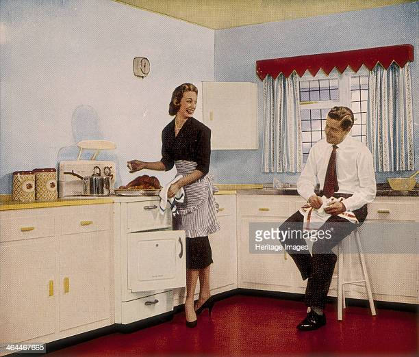 'Who couldn't cook well in a kitchen like this' 1950s A couple happily preparing a roast An advertisement for the paint company Robbialac