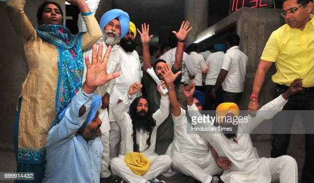 MLA who created ruckus in Vidhan Sabha removed by watch and ward staff of Punjab Vidhan Sabha on the order of Speaker Rana KP Singh protesting at...
