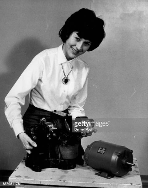 Who Wants the Hefty Motor Mrs Shirlee Finney official hostess for the electrical electronic trade show tries to lift an old quarterhorsepower...