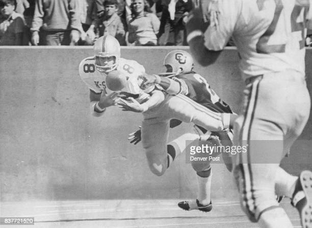 Whoever Heard Of A Flying Pickpocket Wildcat cornerback Johnny Robertson hovers airborne in front of Colorado's Cliff Branch on his firstseries...
