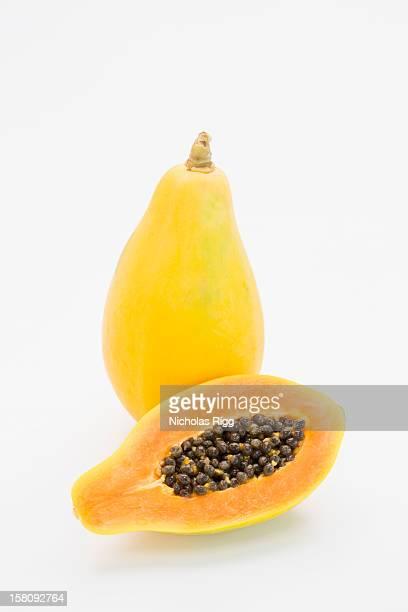 A whole and a half a papaya fruit