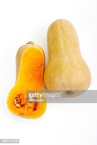Whole and a half of butternut squash in front of white background
