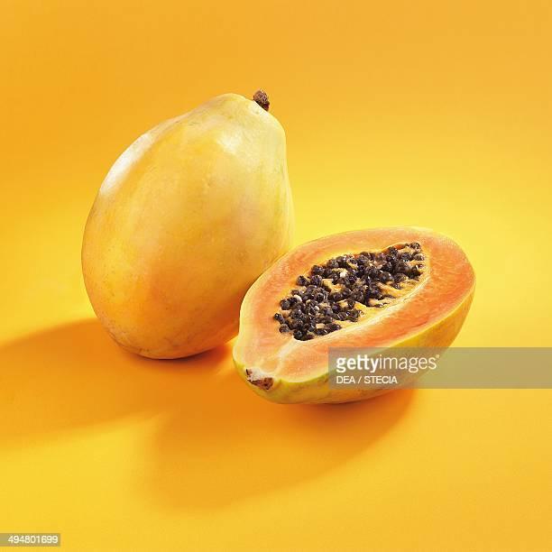 Whole and cut papaya or papaw