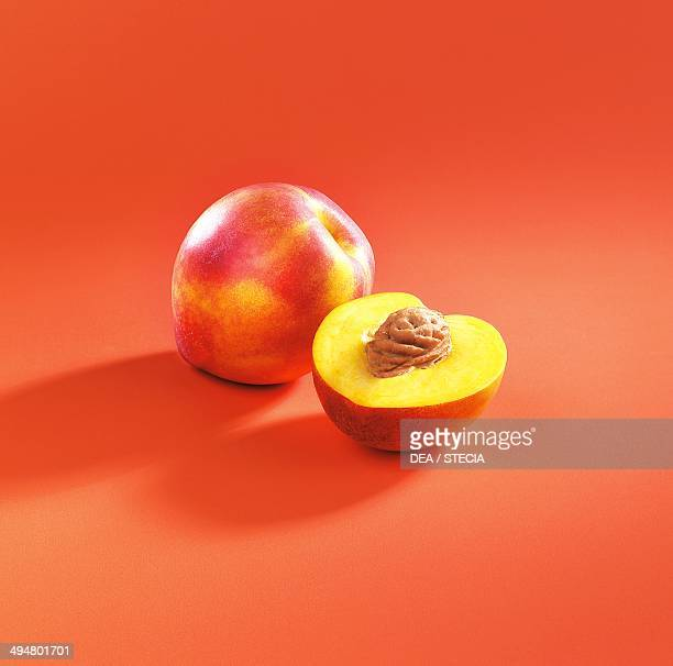 Whole and cut peach or nectarine