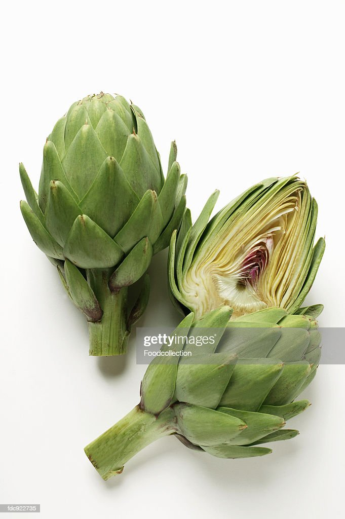 Whole and half artichoke : Stock Photo