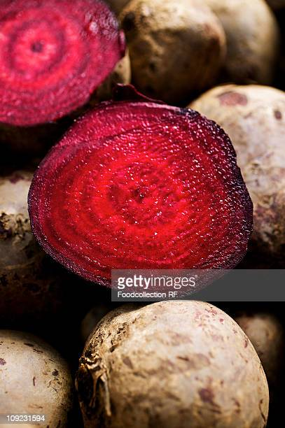 Whole and halved beetroot, close-up