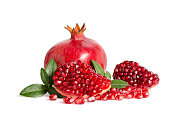 whole and part of Pomegranate with leaves isolated on white