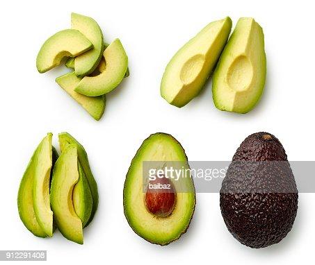 Whole and sliced avocado : Foto de stock