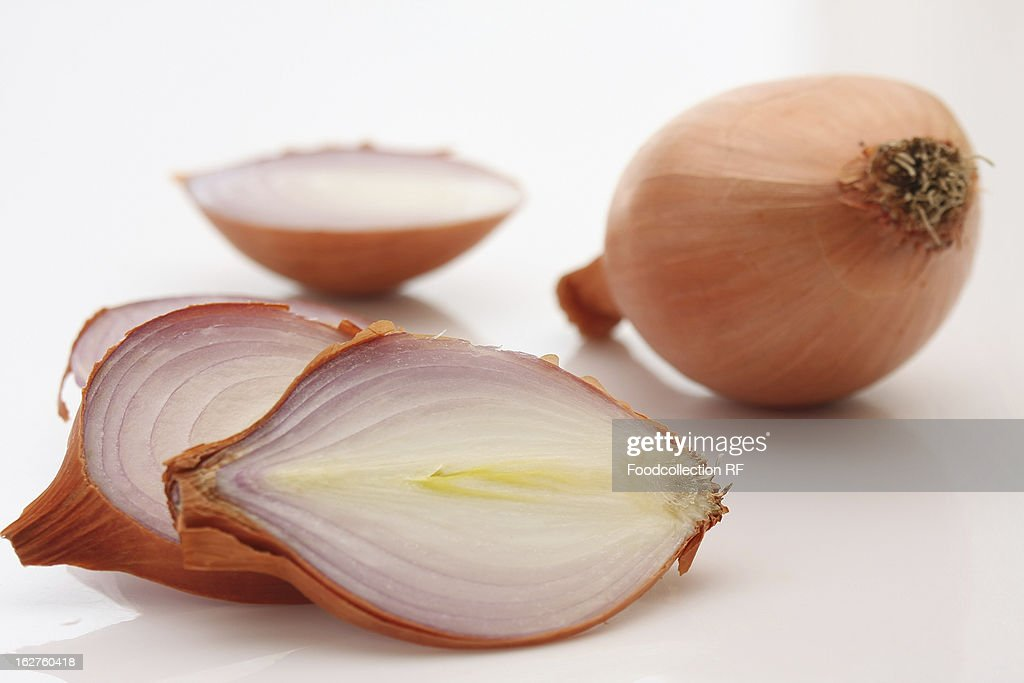 Whole and sliced onions on white background : Stock Photo