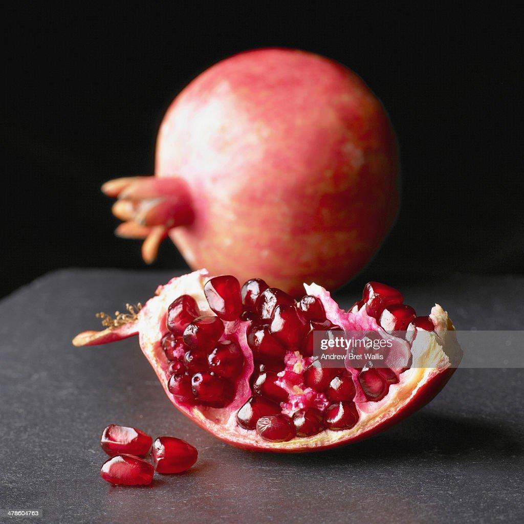 Whole and sliced pomegranates