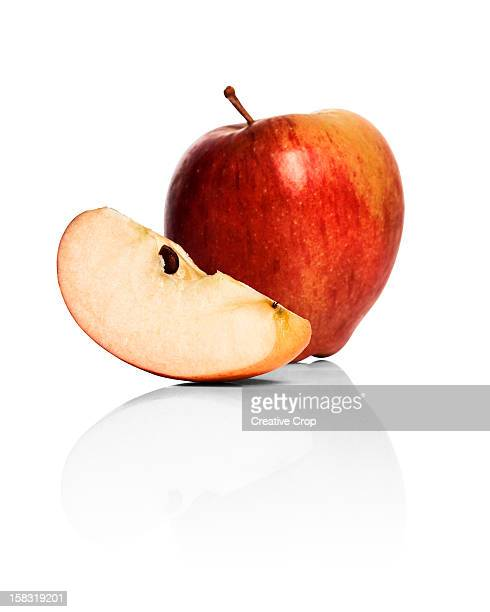 A whole apple and apple wedge