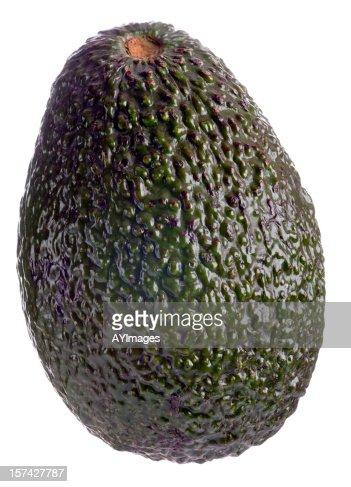 Whole avocado on white background