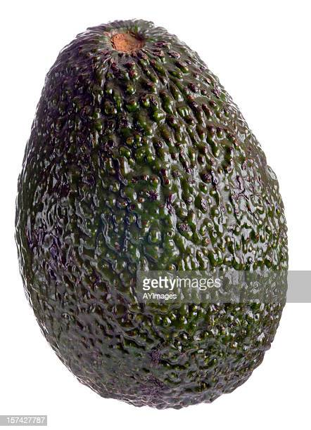 Whole avocado on white background
