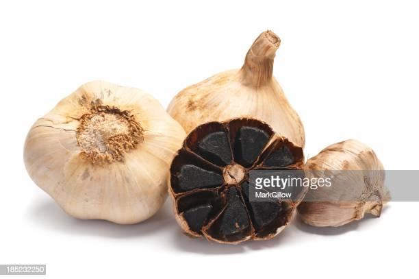 Whole black garlic isolated on a white background