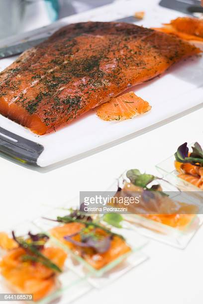 Whole cured salmon Gravadlax and small appetizers