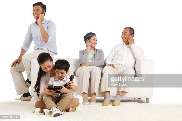 Whole family making phone call