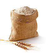 Whole flour in burlap on white background