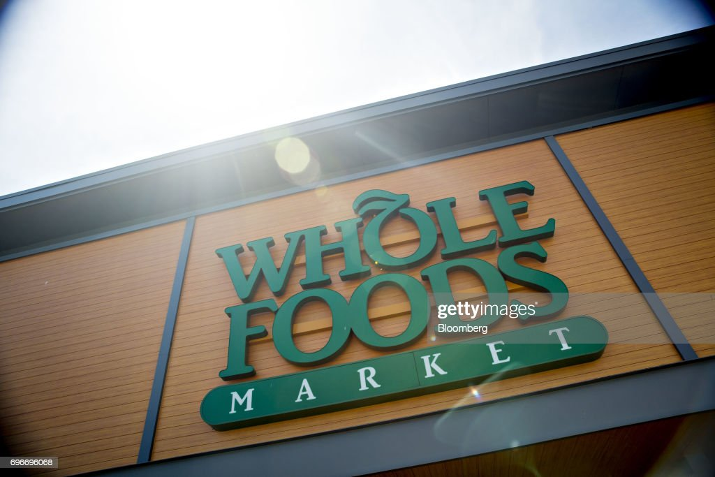 A Whole Foods Market Inc. location stands in Willowbrook, Illinois, U.S., on Friday, June 16, 2017. Amazon.com Inc. will acquire Whole Foods Market Inc. for $13.7 billion, a bombshell of a deal that catapults the e-commerce giant into hundreds of physical stores and fulfills a long-held goal of selling more groceries. Photographer: Daniel Acker/Bloomberg via Getty Images