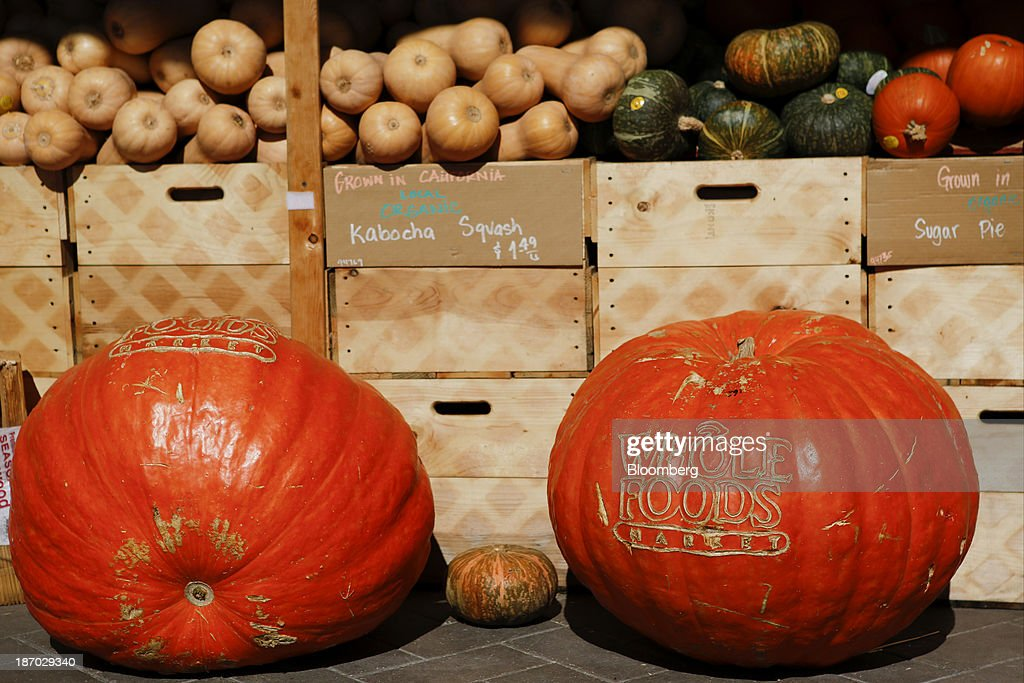 Whole Foods Market Inc. signage is carved into pumpkins displayed outside of a location in El Segundo, California, U.S., on Tuesday, Nov. 5, 2013. Whole Foods Market Inc. is scheduled to release earnings figures on Nov. 6. Photographer: Patrick T. Fallon/Bloomberg via Getty Images