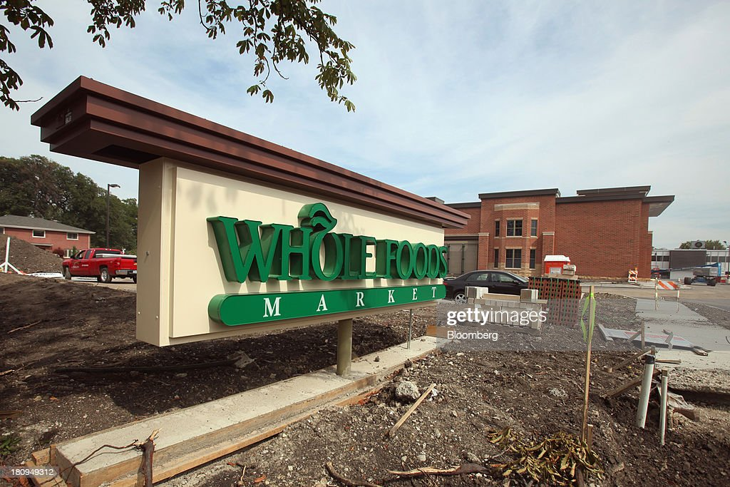 Whole Foods Market Inc. signage sits outside a new store under construction in Park Ridge, Illinois, U.S., on Tuesday, Sept. 17, 2013. Whole Foods is currently scheduled to open eleven new stores in the U.S. and 2 in the U.K by the fall 2014, according to its website. Photographer: Tim Boyle/Bloomberg via Getty Images