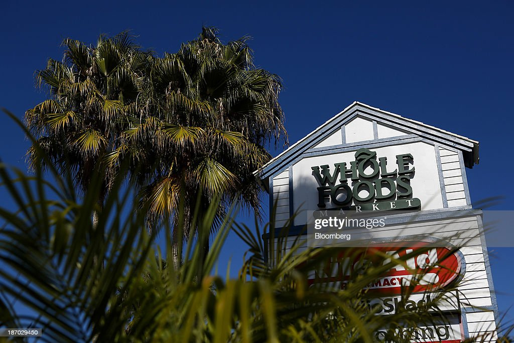 Whole Foods Market Inc. signage stands next to palm trees outside of a location in Redondo Beach, California, U.S., on Tuesday, Nov. 5, 2013. Whole Foods Market Inc. is scheduled to release earnings figures on Nov. 6. Photographer: Patrick T. Fallon/Bloomberg via Getty Images