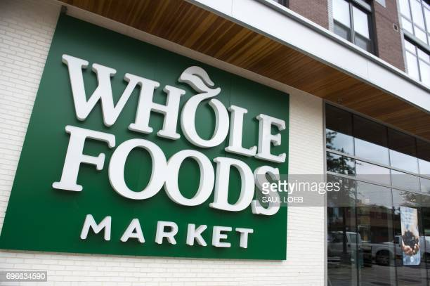 A Whole Foods Market sign is seen in Washington DC June 16 following the announcement that Amazon would purchase the supermarket chain for $137...