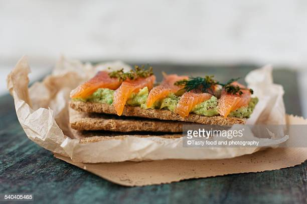 Whole grain flatbread, avocado and salted salmon