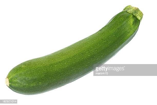 Whole green zucchini on a white background