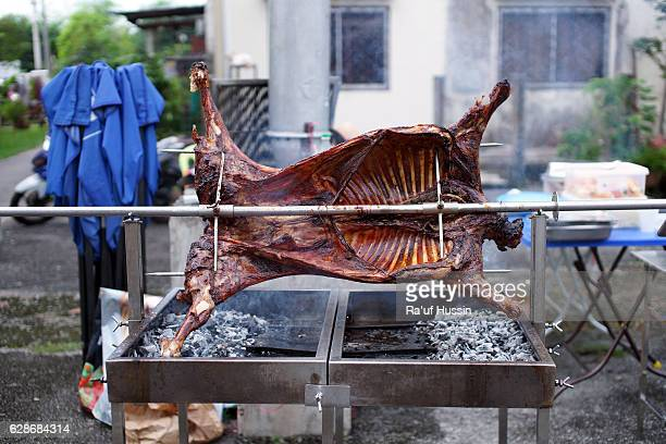 Whole lamb on skewer grilled to perfection using hot charcoal