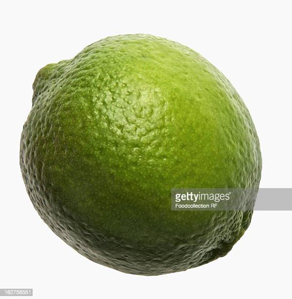 Whole lime with water drops