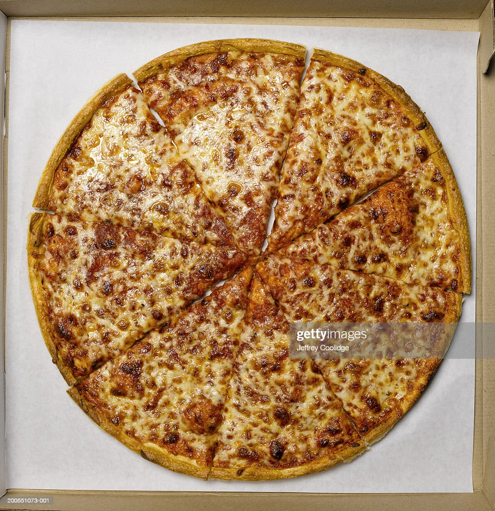 Whole pizza in box, overhead view