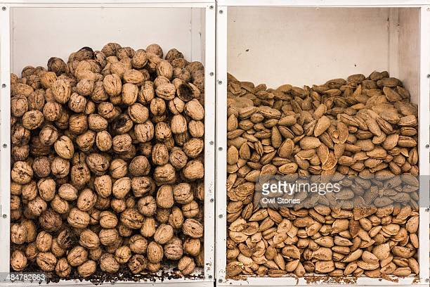 Whole walnuts and almonds in display box