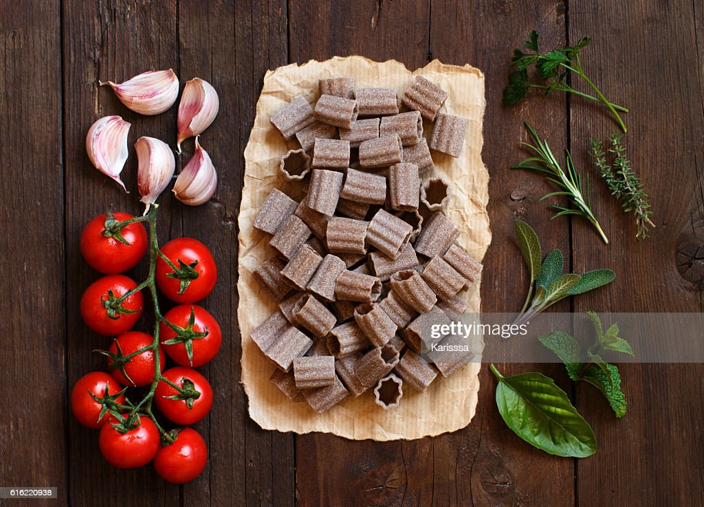 Whole wheat pasta, vegetables and herbs : Stock Photo
