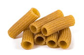 Rustic rigatoni pasta isolated on white background