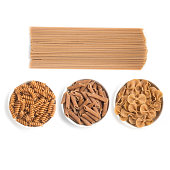 Wholemeal Pasta. Spaghetti, Penne and Fusilli isolated in white background