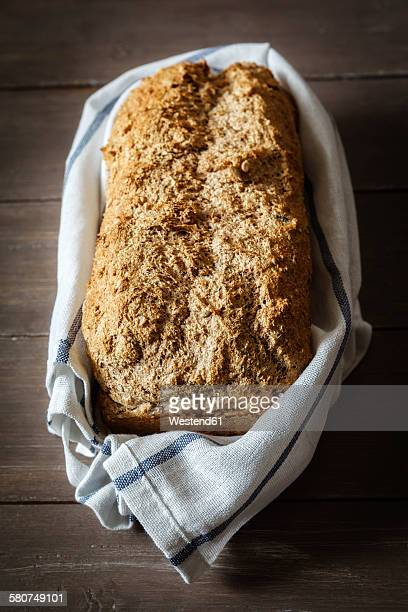 Wholemeal spelt bread and kitchen towel