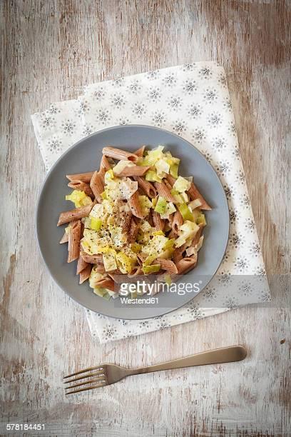 Wholemeal spelt rigatoni with leek cream sauce on plate