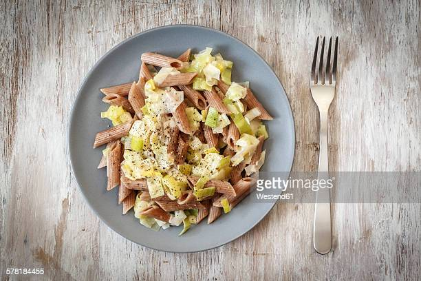 Wholemeal spelt rigatoni with leek cream sauce on plate