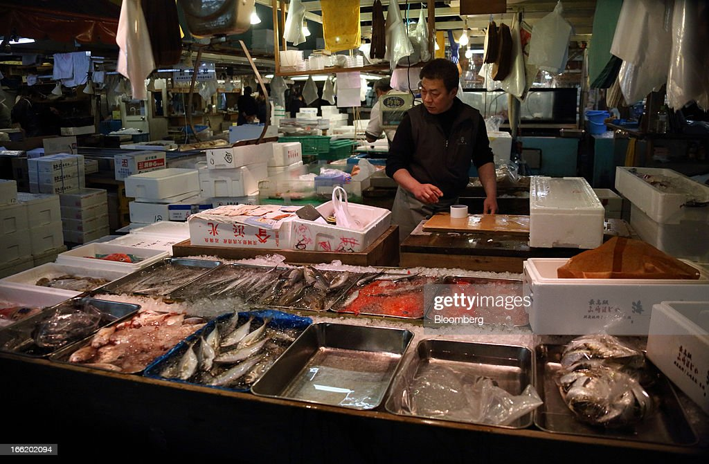 A wholesaler displays fish for sale at Tsukiji Market in Tokyo, Japan, on Tuesday, April 9, 2013. After Bank of Japan Governor Haruhiko Kuroda's first policy meeting as governor on April 4, the central bank set a two-year horizon for the 2 percent annual price-increase target that it adopted in January at the urging of Prime Minister Shinzo Abe. Photographer: Tomohiro Ohsumi/Bloomberg via Getty Images