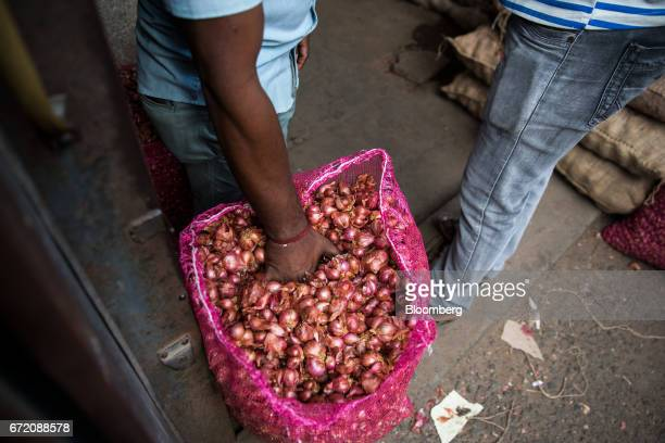 A wholesaler examines a bag of onions in the Pettah neighborhood of Colombo Sri Lanka on Thursday April 20 2017 The Central Bank of Sri Lanka is...