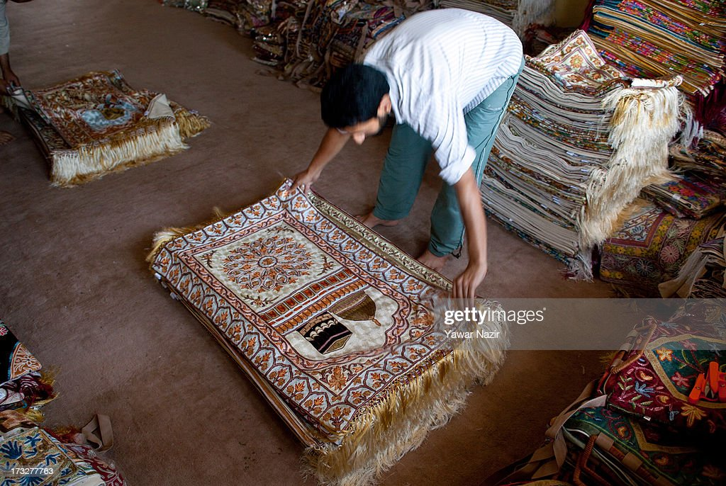 Wholesalers deal in prayer mats, of which they say they export nearly 50,000 to Arab countries in the holy month of Ramadan, on July 11, 2013 in Srinagar, the summer capital of Indian administered Kashmir, India. Ramadan is the ninth month of the Islamic lunar calendar, during which Muslims believe the Quran was given to Prophet Muhammad. Muslims across the globe abstain from eating, smoking, and sex from dawn to dusk during the month. Besides spending more time praying, donating alms is mandatory. Every Muslim has to give 2.5 percent of their wealth and assets to the poor, and often give more.