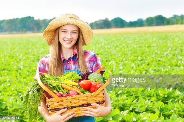 Wholesome Farm Girl Holding Fresh Produce and Vegetable Field Harvest