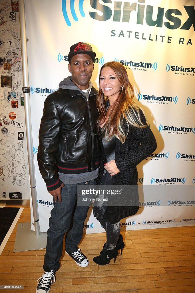 DJ Whoo Kid and Drita D'Avanzo invade 'The Whoolywood Shuffle' at SiriusXM Studios on December 2, 2013 in New York City.